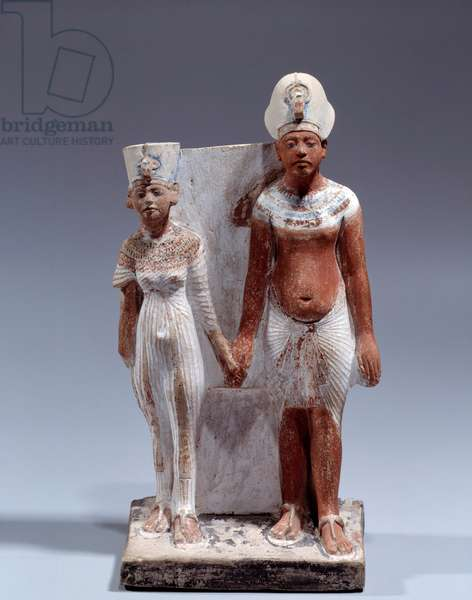 Egyptian antiquite: Amenophis IV (Akhenaton) and Nefertiti, 1353-1337 BC (Amarnian Period), Sculpture in painted limestone, Dim. 0,22x0,12 m, Provenance of Tell el-Amarna, Musee du Louvre, Paris - Statuette of Amenophis IV (Akhenaten) and Nefertiti, Amarna Period, New Kingdom, 1353-1353-1353-1337 BC, New Kingdom, painted limestone, from Tell el-Amarna, 0,22x0,12 m, Louvre Museum, Paris