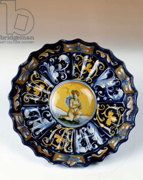 Godronnee faience cup decoree of an angelot. 16th century Egouen. National Renaissance Museum