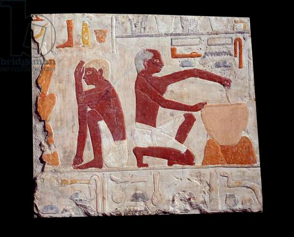 Ancient Egyptian art: baking bread. One man makes cake paste, another one monitors the baking of bread molds. Limestone (2500-2350 BC) 5th dynasty. Paris, Musee Du Louvre