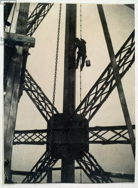 Painter on the Eiffel Tower in 1889, Paris