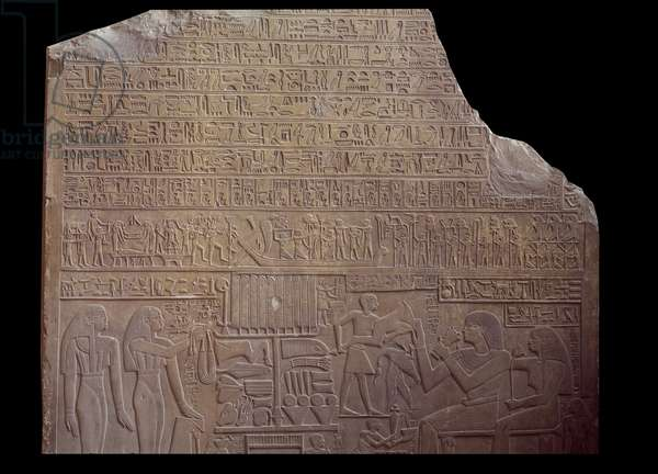 Egyptian antiquite: funerary stele covered with an inscription in code language in the form of hieroglyphs. Paris, Louvre Museum