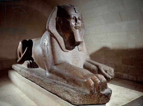 Egyptian antiquite: the Great sphinx usurp by Ramses II and his son Merenptah 1st (or Mineptah, Merneptah). Pink granite sculpture. Paris, Louvre Museum