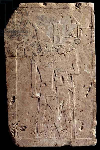 Egyptian antiquite: limestone relief depicting King Qahedjet (Kahedjet) embraces by the god Horus. Old empire. End of the 3rd dynasty. 2700-2620 BC. Paris, Louvre Museum