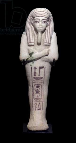 Ancient Egyptian Art: Ushebti of Tutankhamun. Silicone faience, circa 1330 BC. Paris, Musee Du Louvre.