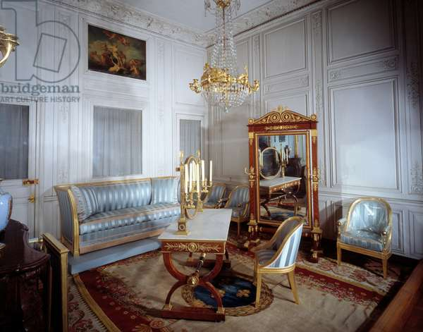 View of the bathroom of the Impress Josephine de Beauharnais: psyche and toilet table in mahogany from Thomire, canape (on a stage hiding the bathtub in the floor) and armchairs by Jacob-Desmalter.19th century Fontainebleau. Chateau Museum