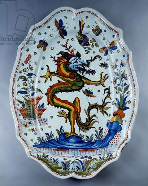 Faience dish decorated with a dragon. 18th century Sevres.