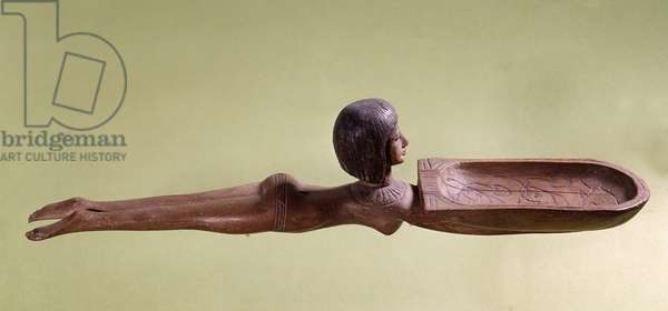 Egyptian antiquite: Wooden spoon for cosmetic spoon called a naked swimmer holding a duck. 18th dynasty, new empire. Paris, Louvre Museum