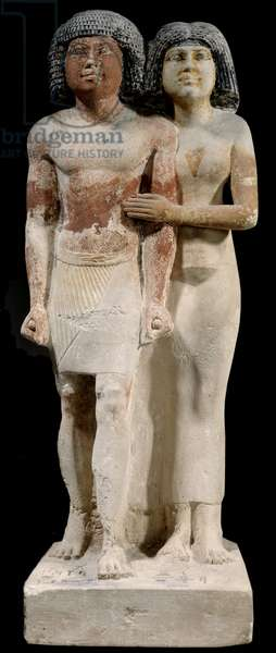 Egyptian antiquite: Limestone statue of Raherka and Meresankh couple. 5th dynasty. Old empire (around 2700-2200 BC). Sun 0,52x0,21 m Paris, musee du Louvre