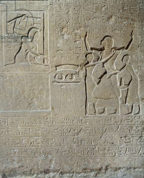 Egyptian antiquite: relief in limestone of Hormin: Sethi I distributes the collars of valour as a reward for his courage to Hormin, head of the king's harem. 19th dynasty (1295-1186 BC). Paris Louvre Museum