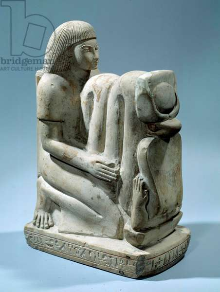 Egyptian antiquite: limestone statue of Setaou with the goddess Cobra Nekhbet. 18th dynasty (circa 1550-1295 BC). Paris, Louvre Museum