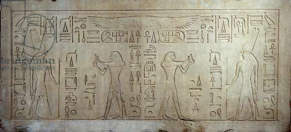 Egyptian antiquite: limestone stele depicting King Sesostris III (1862-1843 BC) (left) as a young man, on the right, an age man offers bread and cake to the god Monti. 1878-1843 BC. From medamoud. Paris, Louvre Museum