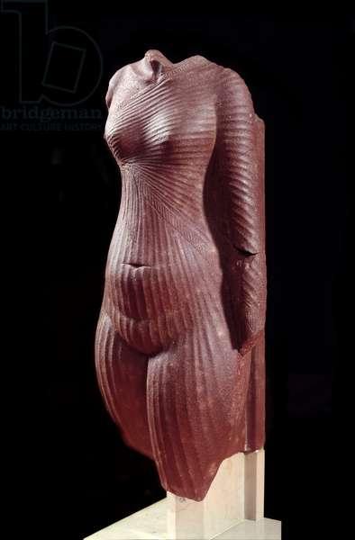 Egyptian antiquitis: torso of Queen Nefertiti or Amarnian princess. 1353-1337 BC. Quartzite statuette. Sun 0,29 m. Paris, Louvre Museum