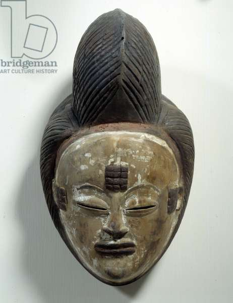 African Art: Mukuyi mask from Gabon made of wood and kaolin powder. Dim. 28 cm Paris, Musee Picasso