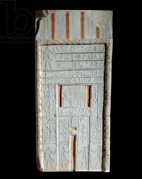 Egyptian antiquite: burial stele or false door made of Chechi limestone. In the center is the scene of the deceased's funeral return. Old empire. Louvre Museum, Paris