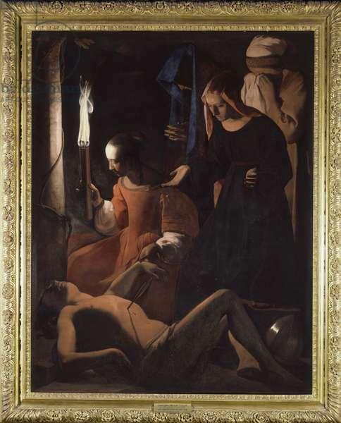 Saint Sebastian is being treated by Saint Irene. (St. Sebastian Tendered by St. Irene) Painting by Georges De La Tour (1593-1652), 17th century. Oil on canvas. Dim: 1,67 X 1,31m. .