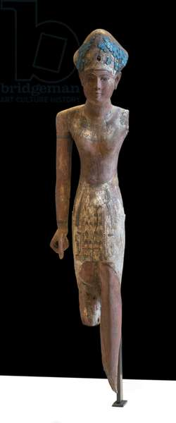 Statue of Sovereign Ramesside headdress of the blue crown and wearing the front loincloth (wood carving)