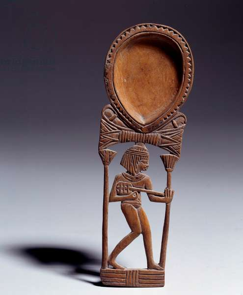Egyptian antiquite: wooden spoon decorated with a young girl playing lute. New Empire (around 1550-1069 BC) Paris, Louvre Museum