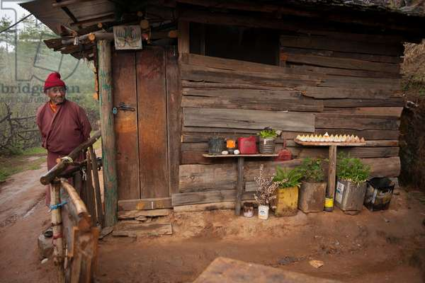 Old monk at his home in the mountains of Bhutan (photo)