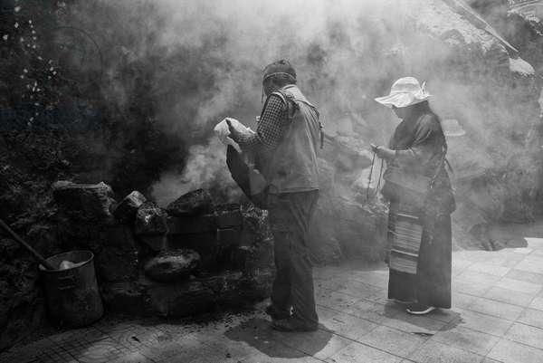 Pilgrims on route to Portala Palace, Tibet (b/w photo)