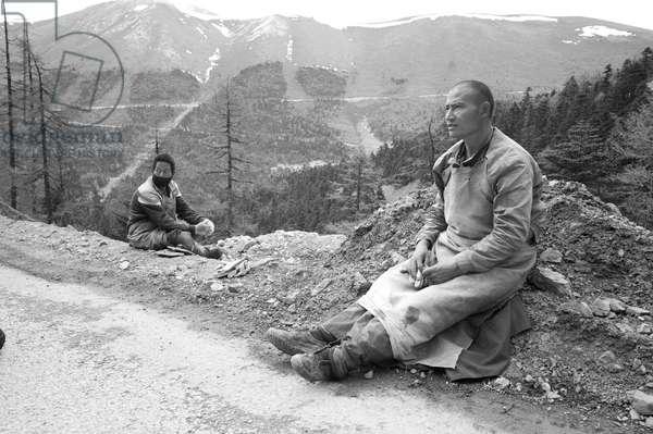 Pilgrim on the road to Shangri La, Yunnan, China (b/w photo)