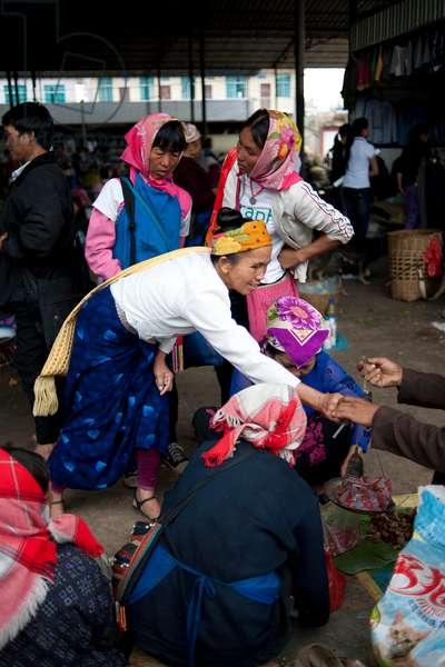 Women outside market, China (photo)