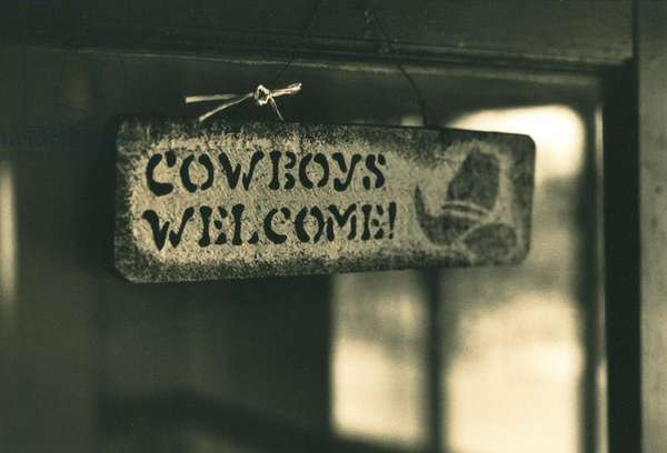 Cowboy sign in the doorway on the Dee ranch Wyoming, USA,1996 (b/w photo)