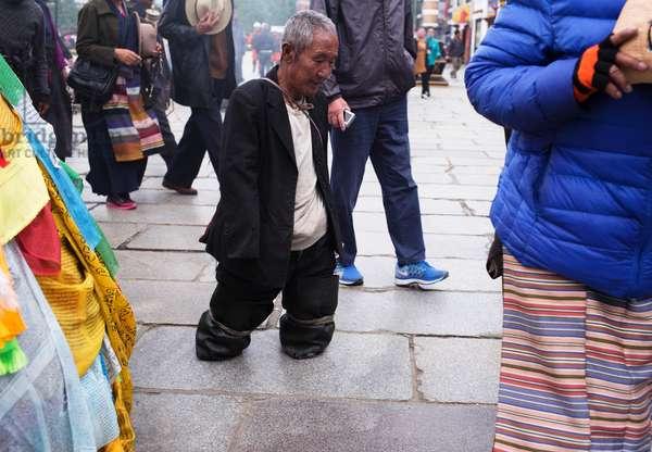Man in main square, Lhasa, Tibet (photo)