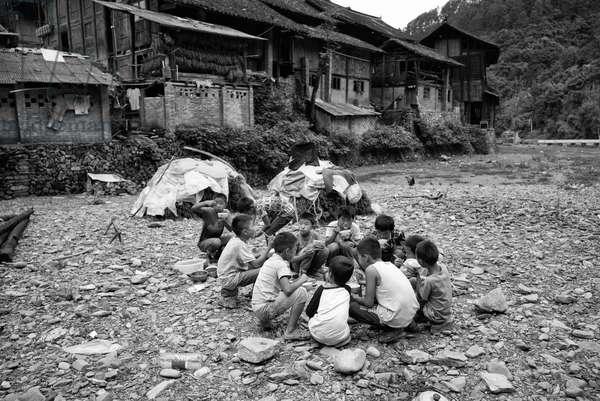 Kids play by river nr Yibin, China (b/w photo)