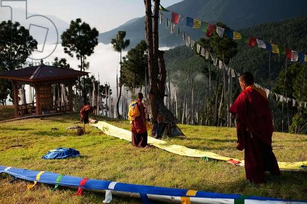 Putting up flags, Nr Punakha, Bhutan (photo)