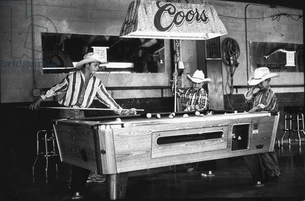 Cowboy kids playing pool Midland, Texas, USA, 1997 (b/w photo)