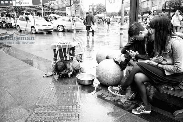 Beggar in Street of Chengdu, China (b/w photo)