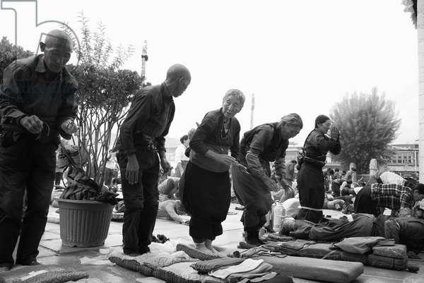 Pilgrims Pray near Portala Palace, Tibet (b/w photo)