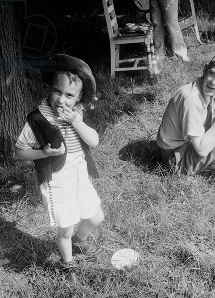 W. H. Auden with a young boy smoking, 1940s (b/w photo)