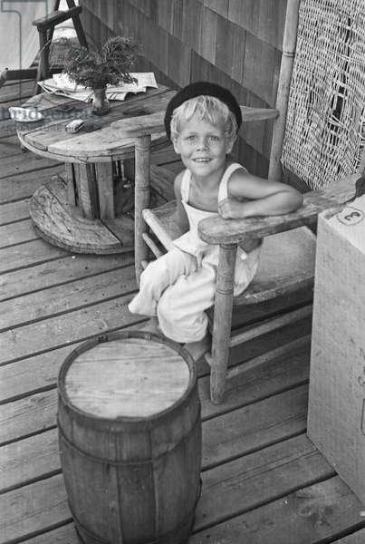 Young boy on a veranda, Fire Island, New York, summer 1946 (b/w photo)