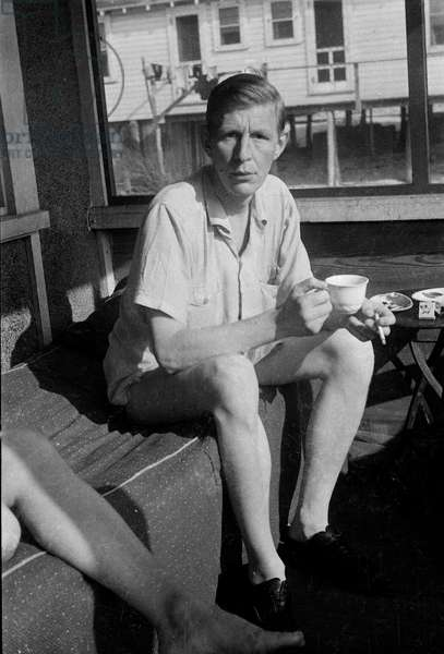 W.H. Auden in the beach house 'Bective Poplars' on Main Walk, in the town of Cherry Grove, Fire Island, New York, 1940s (b/w photo)