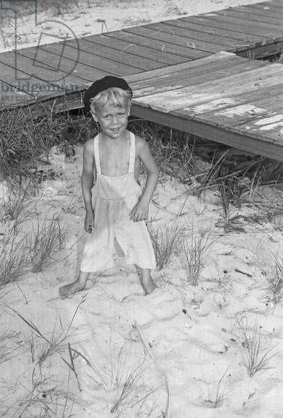 Young boy on the beach, Fire Island, New York, summer 1946 (b/w photo)