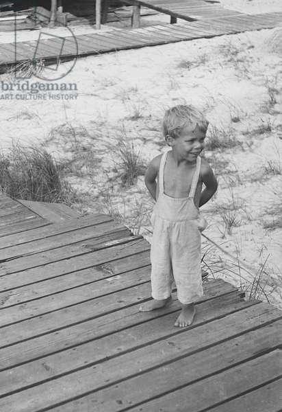 Young boy on a boardwalk, Fire Island, New York, summer 1946 (b/w photo)