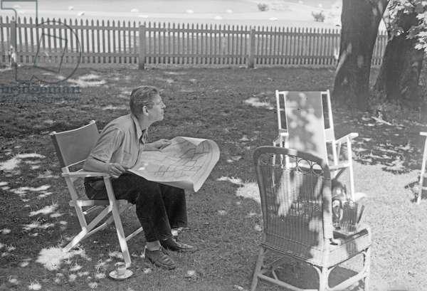 W. H. Auden sitting in the garden, Berwyn, Pennsylvania, summer 1942 (b/w photo)