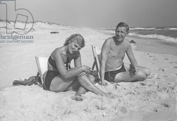 W.H. Auden and Rhoda Jaffe at the beach, Fire Island, New York, Summer 1946 (b/w photo)