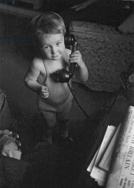 Boy on telephone, New York, August 1945 (b/w photo)
