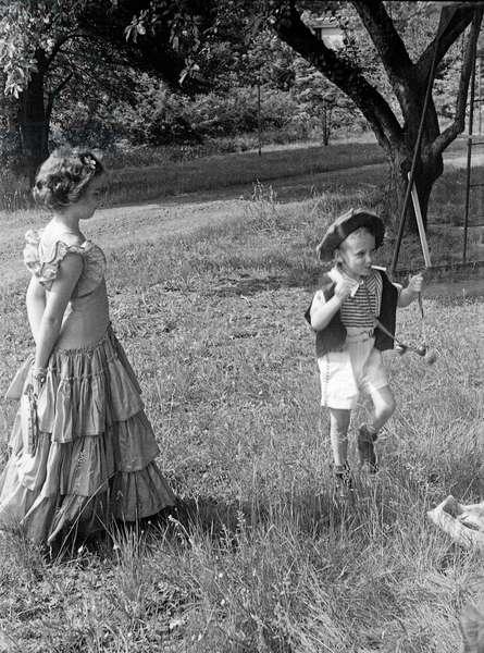 Children playing in the garden, 1940s (b/w photo)