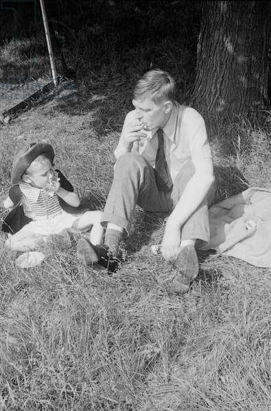 W. H. Auden smoking with a young boy, 1940s (b/w photo)