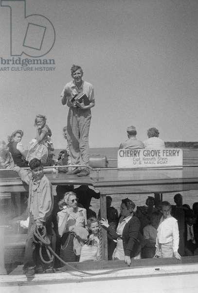 W. H. Auden standing atop the ferry to Cherry Grove, Fire Island, New York, summer 1946 (b/w photo)