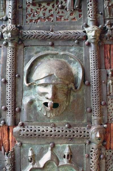 Gargoyle panel from the left door of the portal, 12th century (photo)