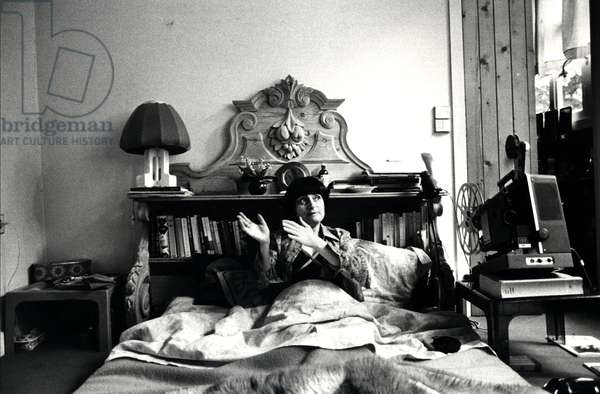 Agnès Varda in her bed at home in Paris, 1977 (b/w photo)