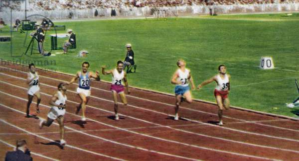 Ira Murchison winning the 1st heat for the 100 metres race in the 1956 Melbourne Olympics (photo)