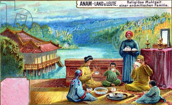 Vietnamese family holding a feast to honour a deceased member of the family on the verandah of their home, 1907 (colour litho)