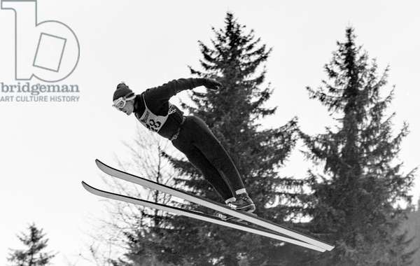 Ski jumper Alibert Vionnet in action at a ski jumping competition in Le Brassus, recorded 1965 (b/w photo)