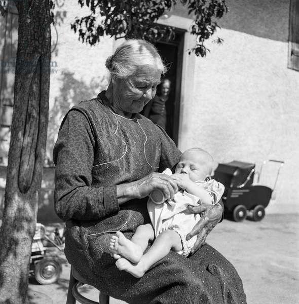 Switzerland Old Woman Infant (b/w photo)