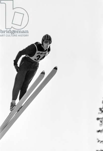 Ski jumper Heini Moser in action at a ski jump in St. Moritz, recorded 1966 (b/w photo)